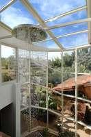 קיר מסך ענק עם גג זכוכית בבית פרטי ביצוע אלומטכניק אקסטל